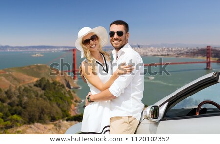 happy woman in convertible car over san francisco Stock photo © dolgachov