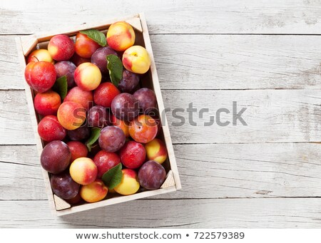 garden plums in wooden box stock photo © karandaev