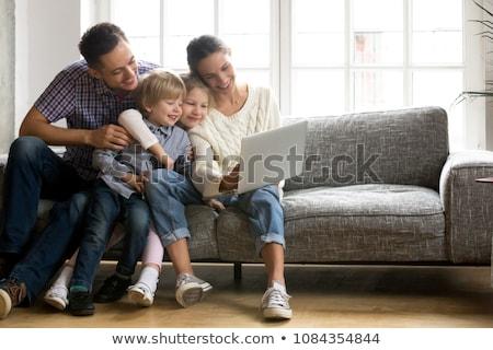 Multi ethnic sibling watching videos Stock photo © Kzenon