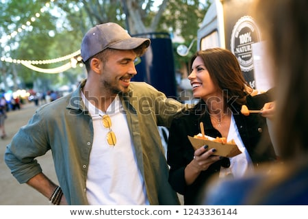 happy customers buying burger at food truck Stock photo © dolgachov