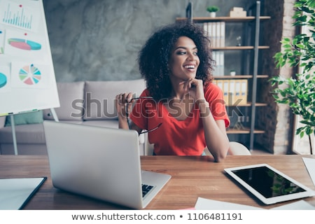 Smiling young business woman dreams about vacation Stock photo © Massonforstock