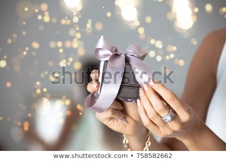 close up of hands with ring in christmas gift box Stock photo © dolgachov