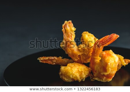 Shrimps tempura in black plate on dark concrete surface Stock photo © artsvitlyna