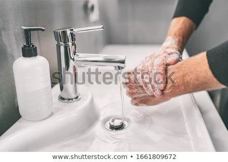Stock photo: Man Washing Hands With Water And Soap In Bathroom