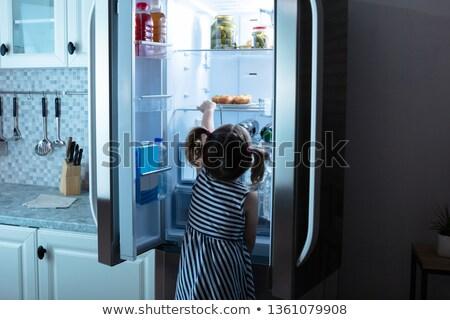 Küçük kız buzdolabı kız Stok fotoğraf © AndreyPopov
