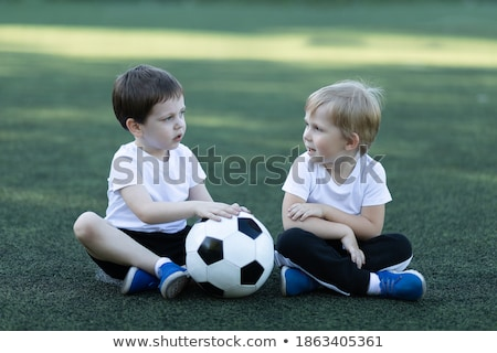 people in park poster two children playing ball stock photo © robuart