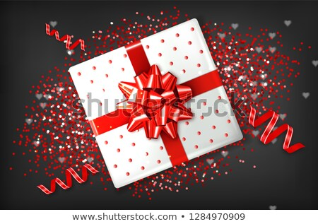 Giftbox with red bow Vector realistic. Confeti and garland sparkle. Product placement mock up. Desig Stock photo © frimufilms