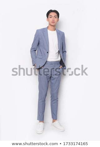 Full length portrait of handsome stylish man with tied hair look Stock photo © deandrobot