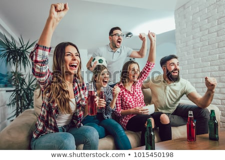 Friends Watching Soccer Match At Home Stock photo © AndreyPopov