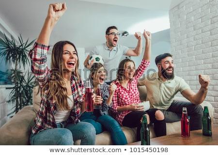 Amigos viendo fútbol partido casa excitado Foto stock © AndreyPopov