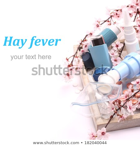Asthma inhalers with blossoming tree branches on wooden tray over white Stock photo © Melnyk