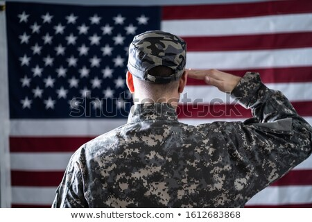 male solider standing in front of an us flag stock photo © andreypopov