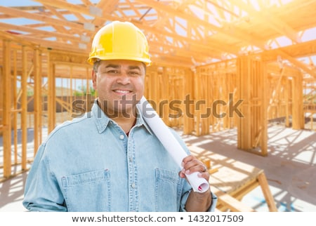 Hispanic Male Contractor with Blueprint Plans Wearing Hard Hat I Stock photo © feverpitch