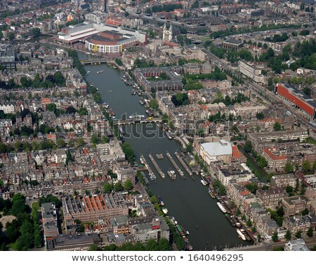 Ponte Amsterdam Holanda árvore canal espelho Foto stock © neirfy