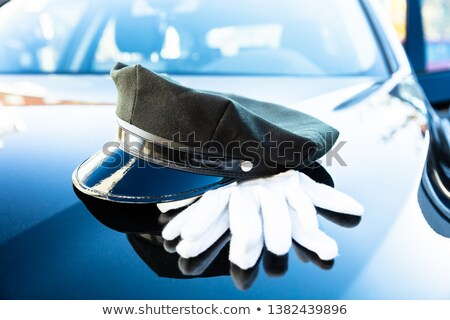 Chauffeur's Cap And Pair Of Gloves On Car Bonnet Stock photo © AndreyPopov