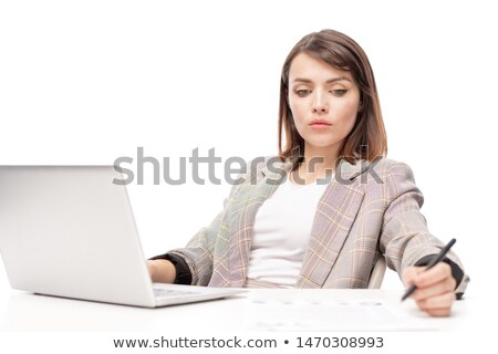 Pensive young woman in formalwear making working notes Stock photo © pressmaster