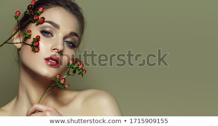Beautiful model woman face with blue eyes and perfect make-up is Stock photo © serdechny