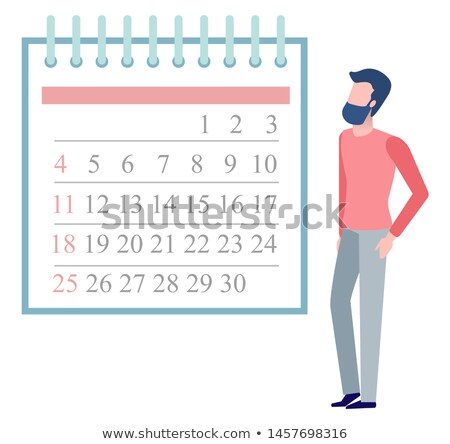 Jonge man naar maand kalender muur vector Stockfoto © robuart