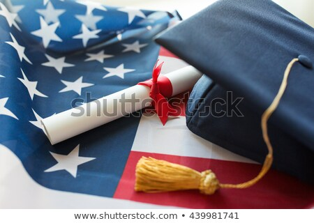 Mezun Öğrenciler amerikan bayrağı eğitim mezuniyet insanlar Stok fotoğraf © dolgachov