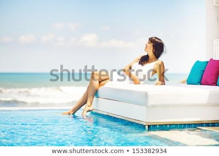 Bella donne letto spiaggia cielo acqua Foto d'archivio © EdelPhoto