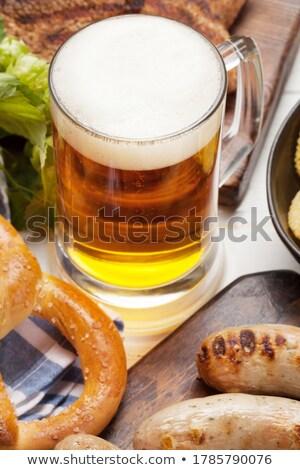 Oktoberfest set. Pretzels, meat and lager beer Stock photo © karandaev