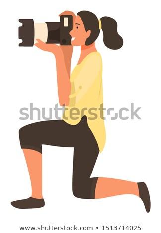 Kobieta paparazzi kolano zawodowych stałego Zdjęcia stock © robuart