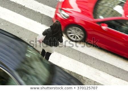 Street road intersection with traffic light. Pedestrian man crosses zebra road Stock photo © orensila