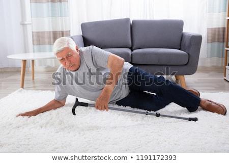 Fallen Senior Man On Carpet Stock photo © AndreyPopov