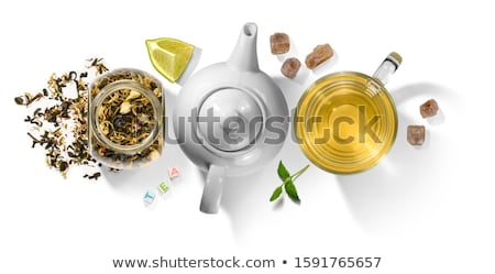 Green tea with natural aromatic additives and accessories. Top view on white background Stock photo © butenkow