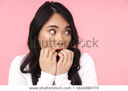 Immagine giovani bruna asian donna paura Foto d'archivio © deandrobot