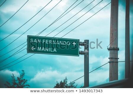 Manila placa sinalizadora verde sinal da estrada nuvem rua Foto stock © kbuntu