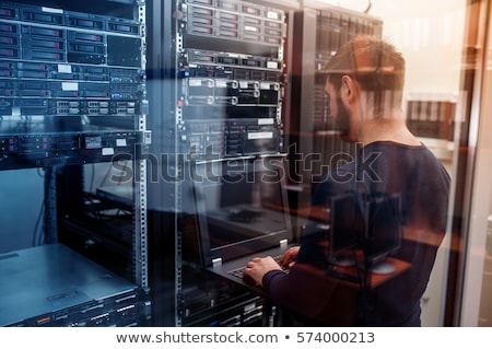 Stock photo: young it engeneer in datacenter server room