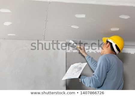 Foto stock: Plasterer Working On Ceiling