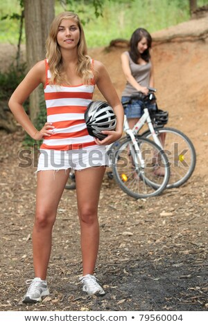 two young women reposing near mountain bikes stock photo © photography33