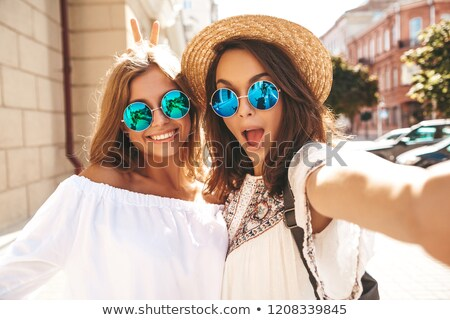 two beautiful woman in chic dresses. Stock photo © Pilgrimego