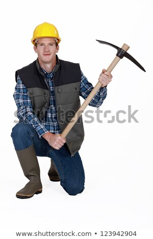 Worker kneeling with pick-ax Stock photo © photography33