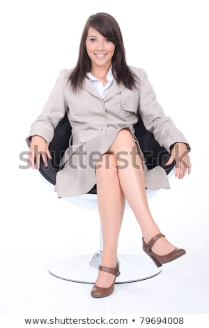 Young woman in a beige skirt suit sitting in a swivel chair Stock photo © photography33
