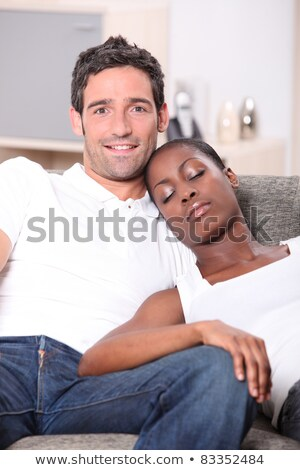 young couple, white man watching us and black woman sleeping on him Stock photo © photography33