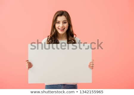 Stock photo: Young woman in casual clothing holding empty board