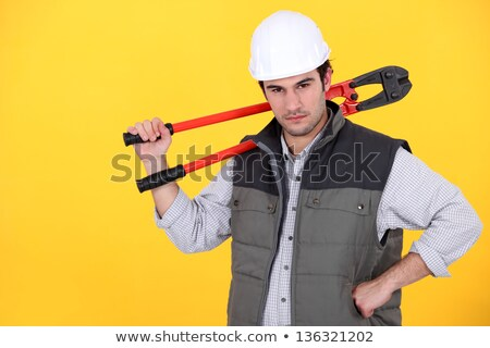 Tradesman carrying a pair of large clippers on his shoulder Stock photo © photography33