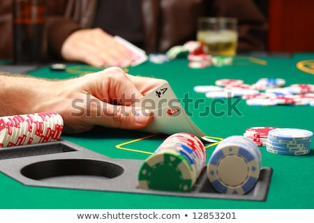 Stock photo: hand with two aces during poker game