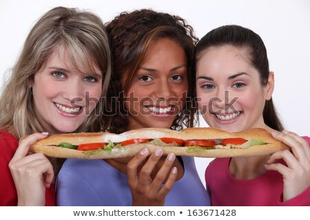 trio of girls eating giant sandwich Stock photo © photography33
