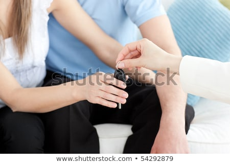 Stock photo: Close-up of a couple receiving their new car's key
