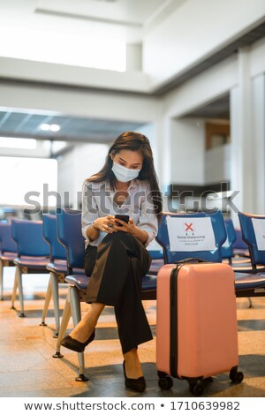 Egészalakos fiatal ázsiai nő ül átlátszó Stock fotó © szefei