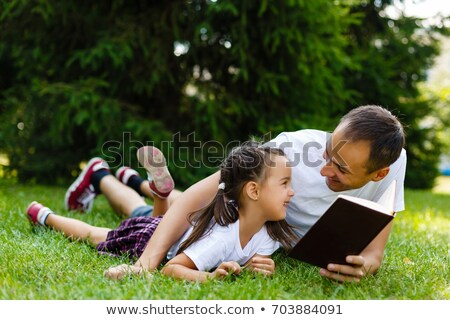 Foto stock: Father With Baby Daughter Reading The Bible