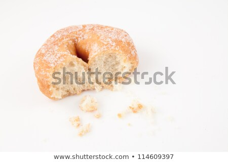 Doughnut with crumbs against white background Stock photo © wavebreak_media
