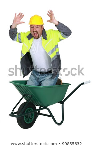 Laborer sitting in a wheelbarrow screaming Stock photo © photography33