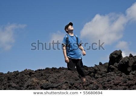 boy walking in volcanic area Stock photo © meinzahn