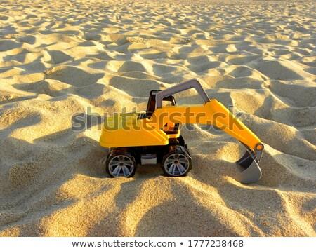 Giocattolo escavatore isolato giallo bianco strada Foto d'archivio © exile7