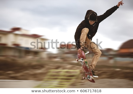 Stock photo: Man Performing Skateboarding Tricks
